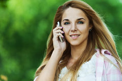 Woman talking on phone Royalty Free Stock Images