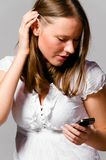 Woman is talking phone Stock Photography
