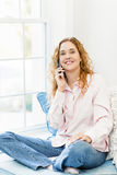 Woman talking on phone Royalty Free Stock Photography