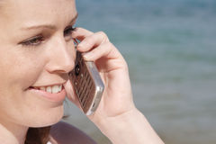 Woman talking on phone. Woman by the sea talking on mobile stock images