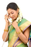 Woman talking with phone stock photography