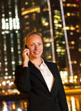 Woman talking on the phone in the big city Royalty Free Stock Images