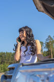 Woman talking on the phone. About a broken machine Royalty Free Stock Photos