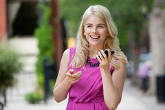 Woman Talking on Phone in City Stock Photo