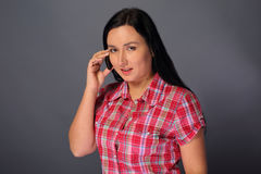 Woman is talking by phone Royalty Free Stock Photos