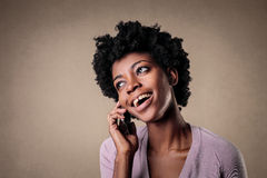 Woman talking on the phone Stock Images