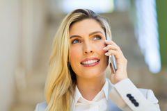 Woman talking on phone Stock Images