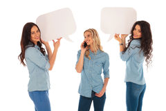 Woman talking on  phone and her friends  holding speech bubbles Royalty Free Stock Image