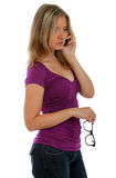 Woman talking on a phone holding glasses Stock Photos