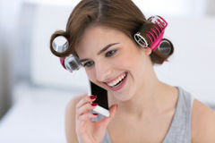 Woman talking on the phone at home Royalty Free Stock Photo
