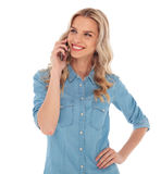 Woman talking on the phone is looking to side Royalty Free Stock Photos