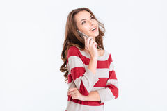 Woman talking on the phone and looking up at copyspace Royalty Free Stock Photo