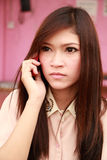 Woman talking on the phone, looking worried. Woman talking on the mobile phone, looking worried Royalty Free Stock Image