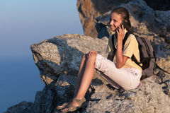 woman talking by phone on the mountain Royalty Free Stock Photo