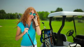 The woman talking on the phone near the cart stock video footage