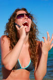 Woman talking by phone near the sea Royalty Free Stock Photo