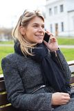 Woman talking on the phone outdoor Royalty Free Stock Image