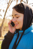 Woman talking on the phone outdoors Royalty Free Stock Photos