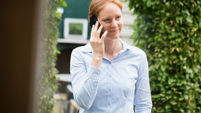 Woman Talking on the Phone Outdoors Royalty Free Stock Image