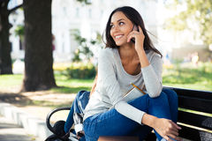 Woman talking on the phone outdoors Stock Image