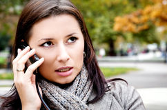 Woman talking phone park Stock Photos