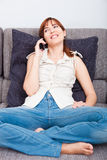 Woman talking on phone Stock Photography