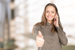 Woman talking the phone and showing Ok sign Stock Image