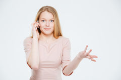 Woman talking on the phone and shrugging shoulders Royalty Free Stock Images