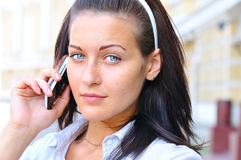 Woman is talking phone at street Stock Photography