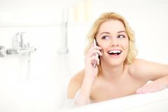 Woman talking on phone when taking a bath Royalty Free Stock Photography