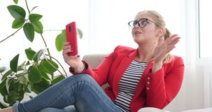 Woman talking on phone via video chat stock footage