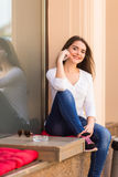 woman  talking on the phone on the window of street coffee shop Royalty Free Stock Images