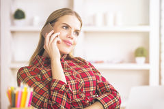 Woman talking on phone and workplace Stock Photography
