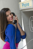 Woman talking in public phone royalty free stock image