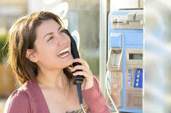 Woman Talking at Public Telephone Royalty Free Stock Images