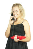 Woman talking by red phone Royalty Free Stock Images