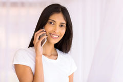 Woman talking  smart phone. Cheerful young indian woman talking on smart phone Royalty Free Stock Photo