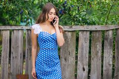 Woman talking on smart phone outdoors. Cropped image of young pr royalty free stock photography