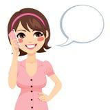 Woman Talking Smartphone. Beautiful brunette young woman talking with smartphone and speech bubble Stock Image