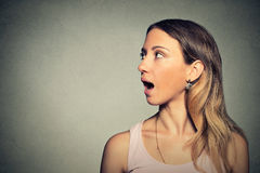 Woman talking with sound coming out of her open mouth Stock Photography