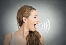 Woman talking with sound waves coming out of mouth
