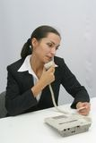 Woman Talking on Telephone. Business woman is calling on a telephone stock photography
