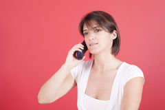 Woman talking on the telephone Stock Photos