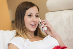 Woman talking telephone Stock Image
