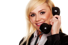Woman talking on a telephone handset Stock Photo