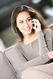 Woman talking on the telephone at home Royalty Free Stock Image
