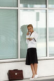 Woman talking on telephone near office Stock Photography