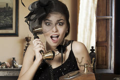 Woman Talking on Telephone Stock Images