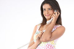 Woman talking with the telephone receiver royalty free stock image