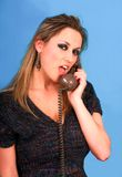 Woman talking in telephone very pretty. Blond woman i blue bacground fun stock photography